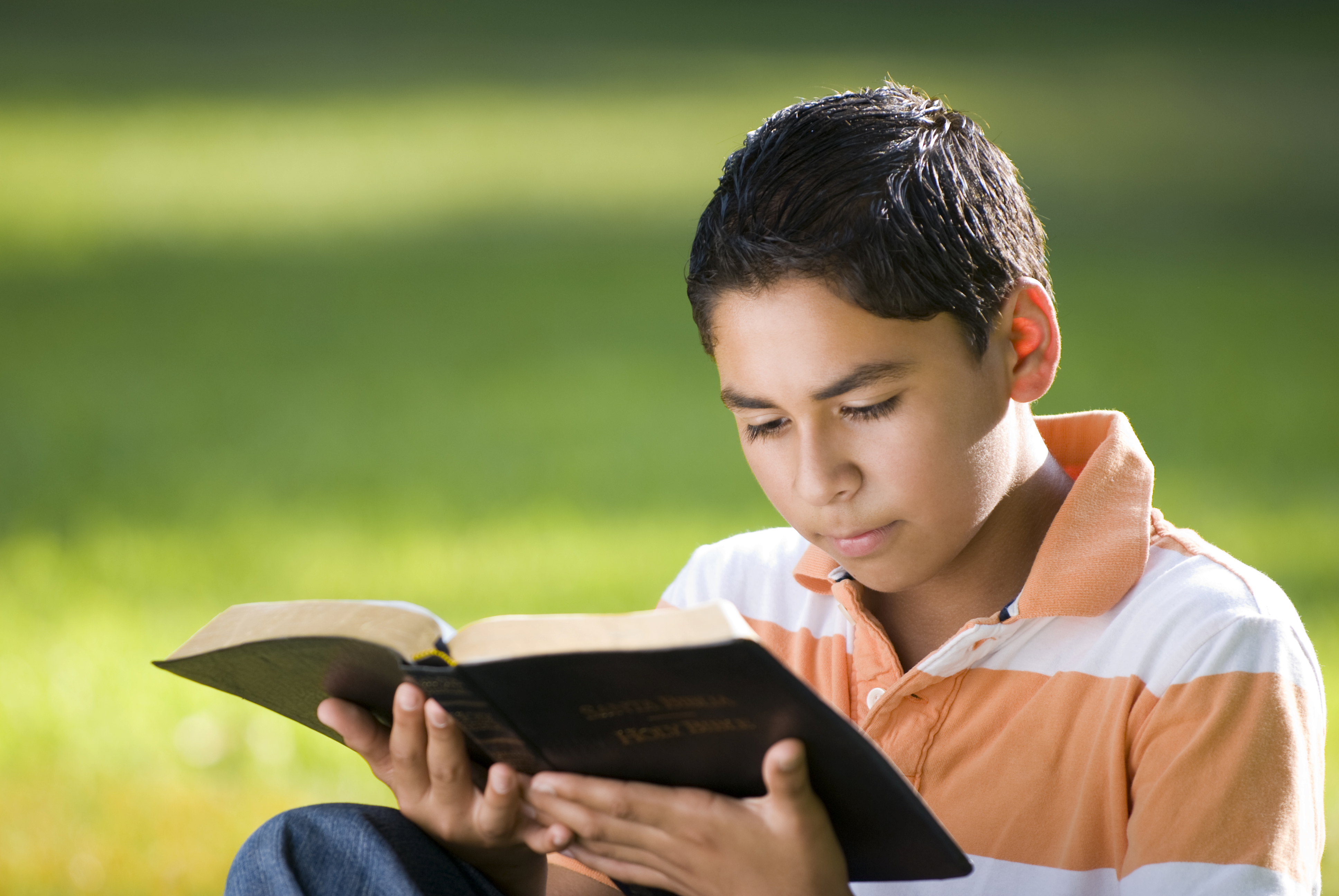 Hispanic boy reading (1)